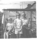 Clive In Grandpop Hopkins garden with Grandpop and Dawn - Hawkins Web Site