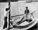 Brother Ted helps Jack raise the sail on the little sailboat - Edward Teddy Ted Moore Kennedy Sr. - MyHeritage Celebrities - John F. Kennedy