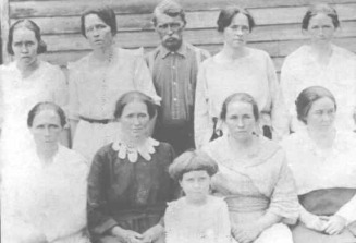 Milams - possibly James Morrow Milam Sr and the lady in black, Dorcus Rebecca Harris - Pelfrey Web Site